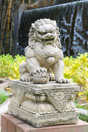 chinese pagoda: Chinese Imperial Lion, Guardian Lion stone, Chinese style sculpture, in chinese temple garden
