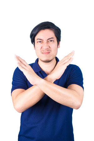 Asian Young man pumped up, making X sign shape with his arms and hands, cross his arms and hands, say no, isolated on white background. Imagens