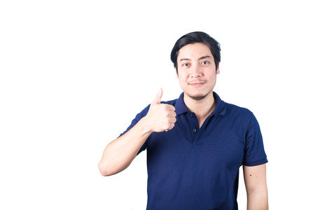 Asian guy making, showing thumbs up with a Smiling, Isolated on white background