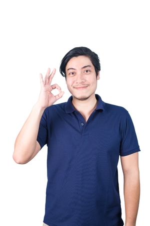 ok sign: Asian handsome may making Ok sign with hand and smiling, isolated on white background. Stock Photo