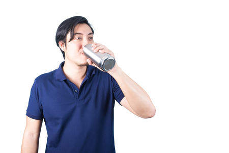man drinking water: Happy Asian man with bottle of water in hand, drinking, isolated on the white background
