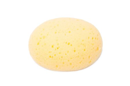 and cellulose: round yellow natural facial cellulose sponge isolated on white background, studio shot.
