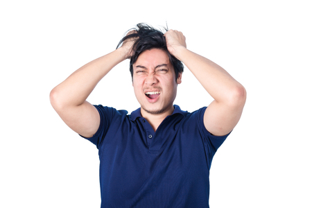 desperation: Asian handsome man holding his head frowning with worry screaming. Man pulling his hear for worry, sadness, desperation, so serious, funny, isolated on white background Stock Photo