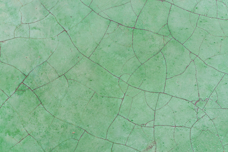 fissure: Crack green polished old concrete floor texture background