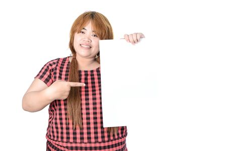 plump: Asian plump woman standing and showing empty vertical blank paper in hands, isolated on white background. Stock Photo