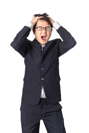 desperation: Asian handsome businessman holding his head frowning with worry screaming. Man pulling his hear for worry, sadness, desperation, so serious, funny, isolated on white background Stock Photo