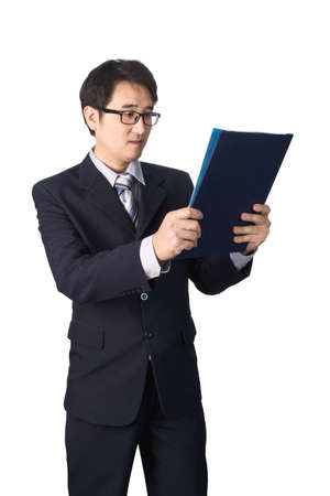 important information: Asian businessman reading important information in file folder, isolated on white background