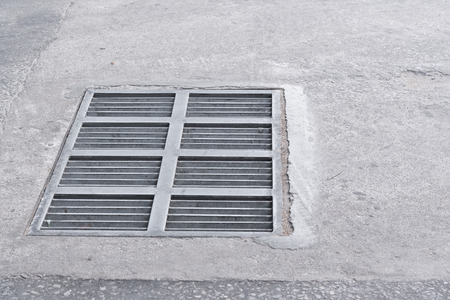 metal grate: Steel Sewer Cover or Manhole cover, sewer grate on the floor