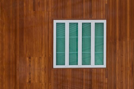 simple frame: Wooden wall with simple white window frame and glass Stock Photo