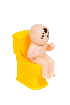 toy toilet bowl: Doll, baby toy sit on yellow toilet bowl, isolated on white background