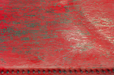 Red scratched metal background and texture