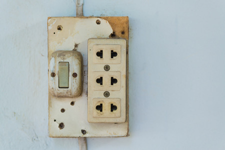 wall socket: Close-up of old socket, electrical outlet, wall socket or outlet plate on the wall