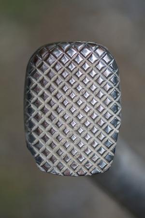 Motorbike metal brake pad, metal texture, pedal brake. Stock Photo