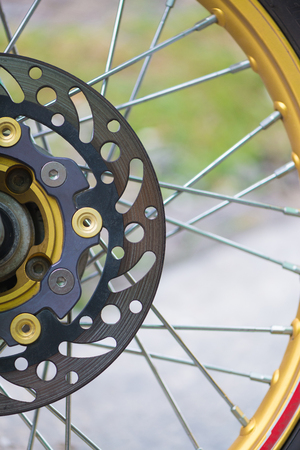 secure brake: Closeup of front motorcycle disk breaks and tire. Stock Photo