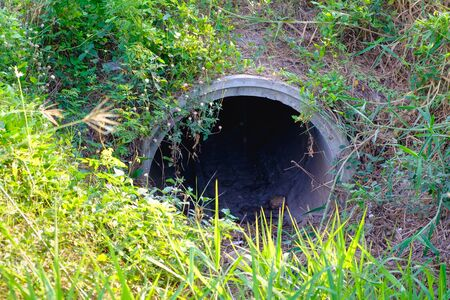 Old concrete drain water in fish farms, drainage and irrigation system.
