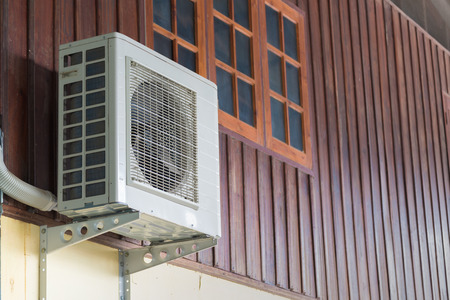 sidewall: Air conditioning units installed outside the house on wooden wall