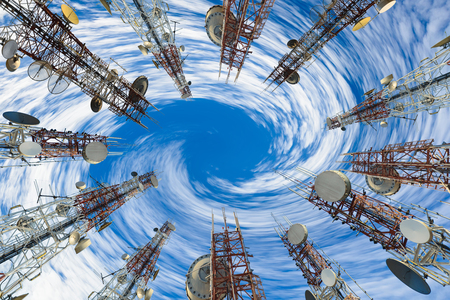 Mobile phone communication antenna tower with cloud and blue sky, Telecommunication tower perspective.  Stock Photo