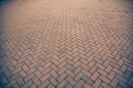 Ancient red brick footpath background walk way. vintage tone with vignetting. Stock Photo