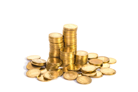 Columns of gold coins, piles of coins arranged on white background, business banking idea, shallow focus. Stock Photo