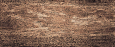 Raw wood, wooden slatted fence or lath wall background texture in vintage tone with vignetting. Stock Photo