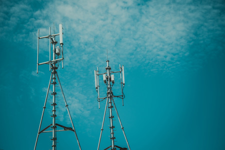 Antennas of cellular and communication systems with the blue sky, signal transmitter. vintage tone with vignetting.