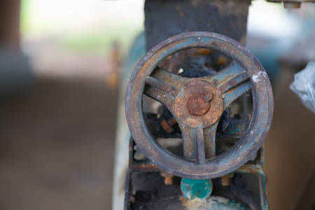 Part of the old rusty gearbox and drive shaft with grunge oil dirty, Vintage engine car system. Stock Photo