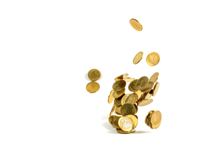Falling gold coins money isolated on the white background, business wealth concept. Stock Photo