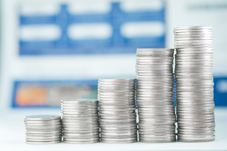 Stacks of coins and account book or credit card with copy space, finance and business finance concept, shallow focus.