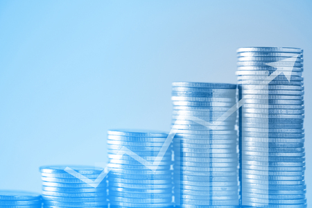 Double exposure stacks of coins on working table with copy space, finance and business concept, shallow focus. Stock Photo