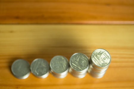 Stacks of coins on working table with copy space, finance and business concept, shallow focus.