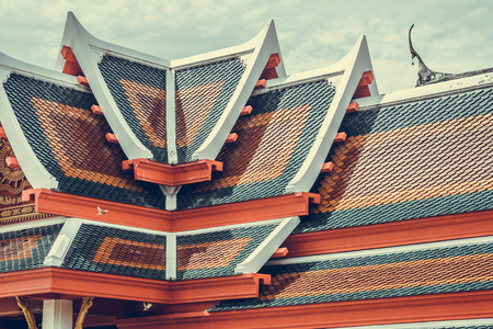 Roof tile texture in Theravada temple, Exterior of Thai Buddhist temple style, Traditional and architecture, rooftop pattern.