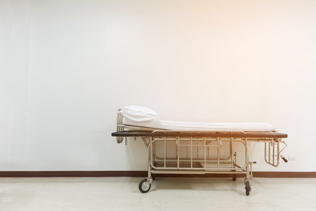 Empty stretcher trolley or hospital trolley waiting for patient with white room. soft tone Stock Photo