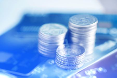 Stacks of coins and account book or credit card with copy space, finance and business finance concept, shallow focus. soft tone. Stock Photo