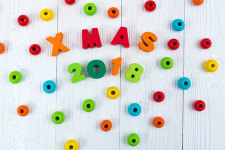 Xmas 2018 colorful wooden text on white wooden desk with Christmas decorations top view top view, Merry Christmas and happy new year concept, template for add text or photo. Stock Photo