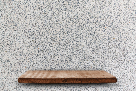 Empty top of wood shelves on the white terrazzo stone wall background. For product display, put product on the top