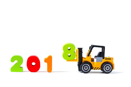 Mini forklift truck loading text number eight to complete year 2018 word, isolated on white background with copy space, happy new year 2018 concept idea.