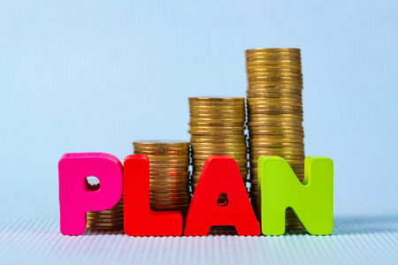 PLAN wooden text and step of coins stack with copy space for add text, financial and business planning concept. idea.
