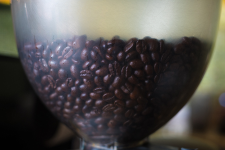 Coffee beans in blender machine at cafe restaurant, shallow or thin focus. Stock Photo
