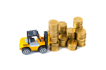 Mini forklift truck loading stack coin with steps of gold coin, isolated on white background with copy space, business finance and banking industrial concept idea.