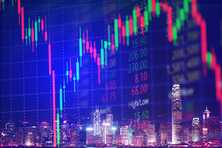 Double exposure of candle stick graph chart with indicator with stock market price screen and city background, stock exchange trading, investment and financial concept idea. Stock Photo