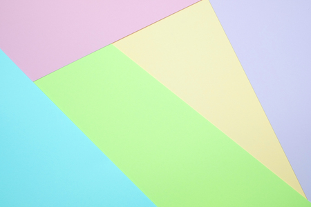 Fashionable  pastel colored paper flat lay top view, geometric background texture, pink, purple, yellow, beige, green and blue colour. Stock Photo