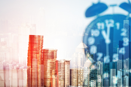 Double exposure of coins stacks and alarm clock with tablet on city background and financial graph, business planning vision and finance analysis concept idea. Stock Photo
