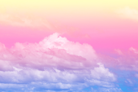 Sweet pastel colored cloud and sky with sun light, soft cloudy with gradient pastel color background. Summer concept. Stock Photo
