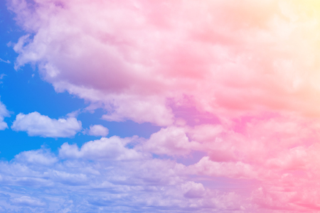 Sweet pastel colored cloud and sky with sun light, soft cloudy with gradient pastel color background. summer concept.