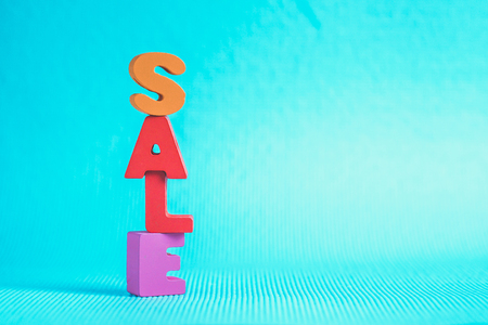 Sale colorful wooden text on blue background with copy space, shopping discount and marketing concept idea. template for add text or photo. Stock Photo