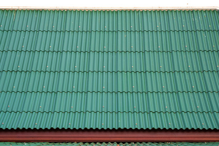 green corrugated metal roof. background and texture.