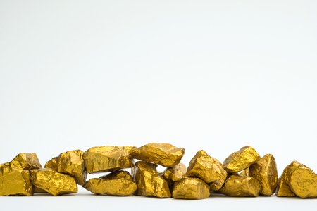 A pile of gold nuggets or gold ore isolated on white background, precious stone or lump of golden stone, financial and business concept idea.