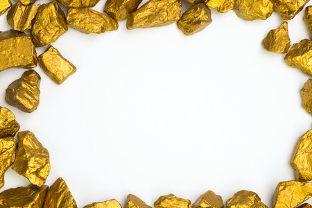 A pile of gold nuggets or gold ore on white background, precious stone or lump of golden stone, financial and business concept idea. Stock Photo