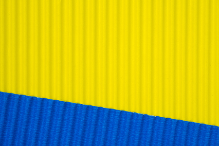 Blue and yellow corrugated paper texture, use for background. vivid colour with copy space for add text or object.