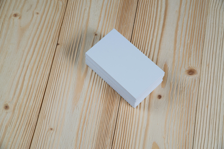 Blank business cards on wooden working table with copy space for add text ID. and logo, business company concept idea.